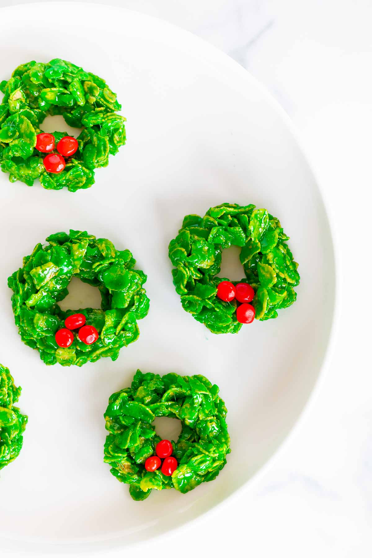 wreath cookies on a white platter