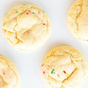Baked funfetti cookies on a white surface.