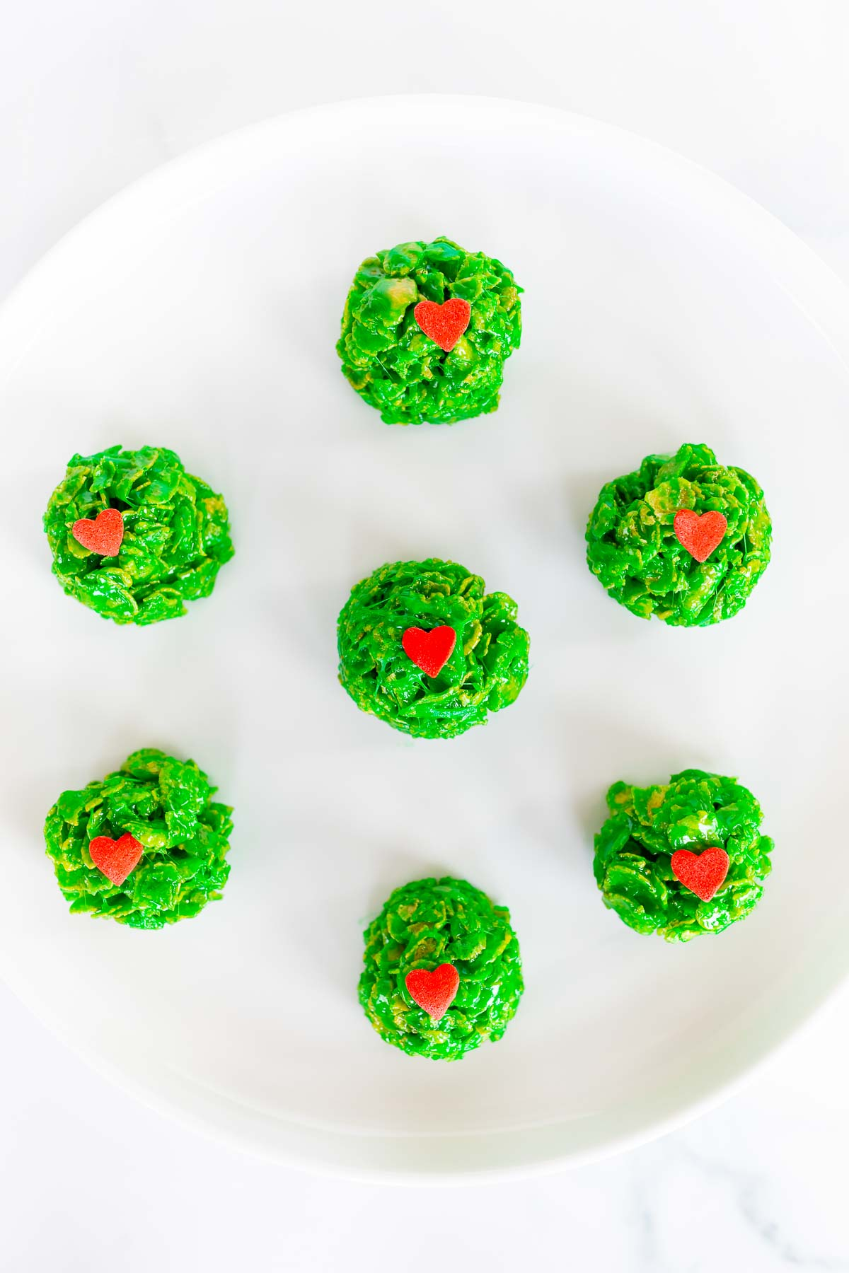 green grinch cookies on white plate