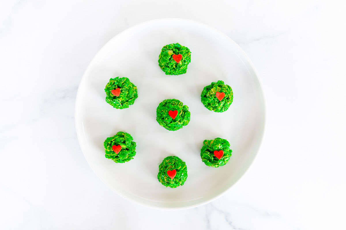 grinch cookies on white platter