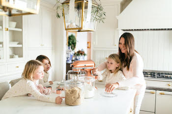 Julie Blanner baking cookies with her daughters