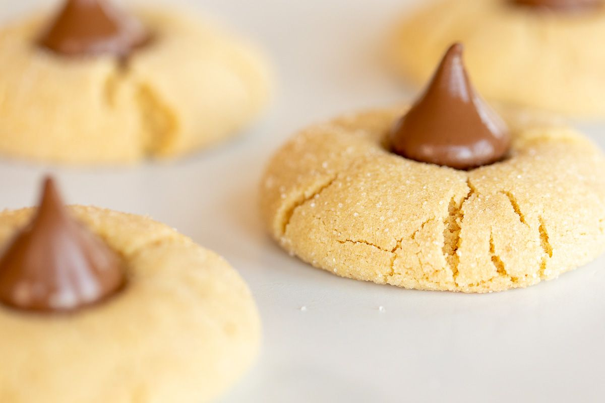 Peanut butter blossoms on a white marble surface.