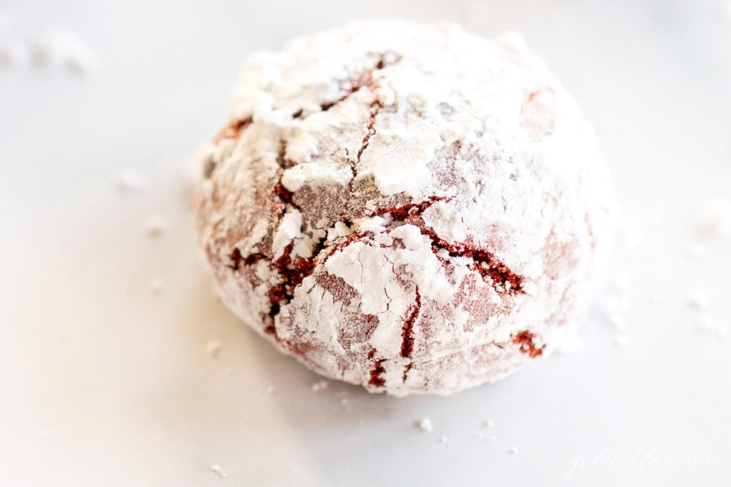 red velvet cookie covered in powdered sugar