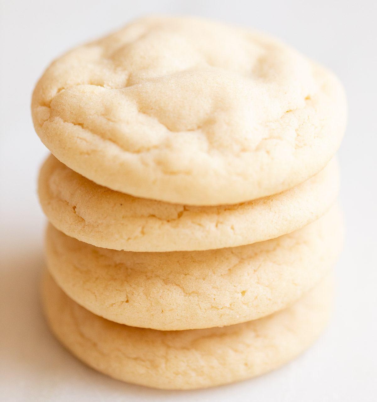 pillowy soft sugar cookies on top of one another
