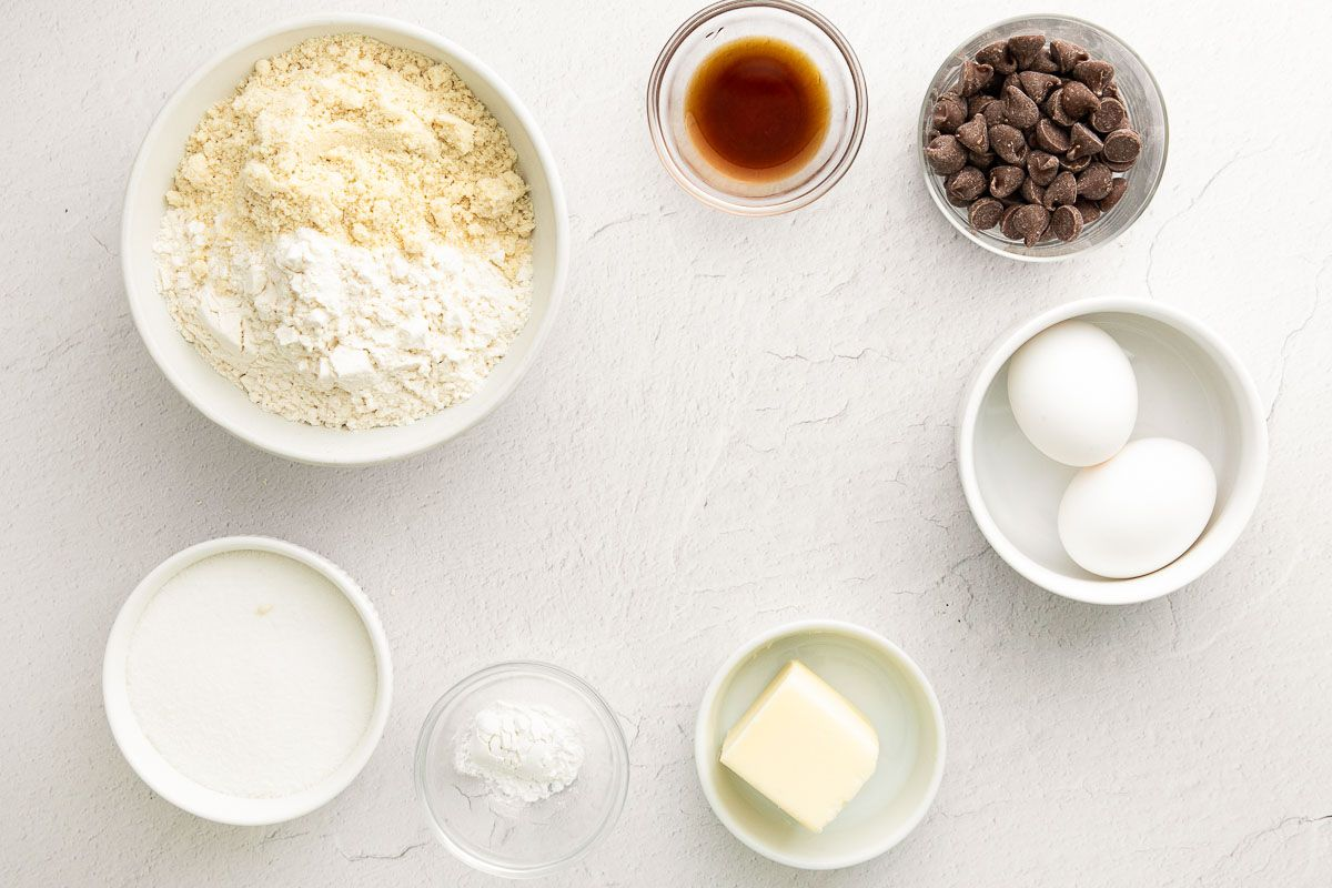 Vanilla biscotti ingredients laid out on a white marble countertop.