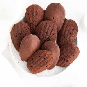 both sides of chocolate madeleines on white plate