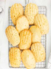 orange madeleines on a wire cooling rack.