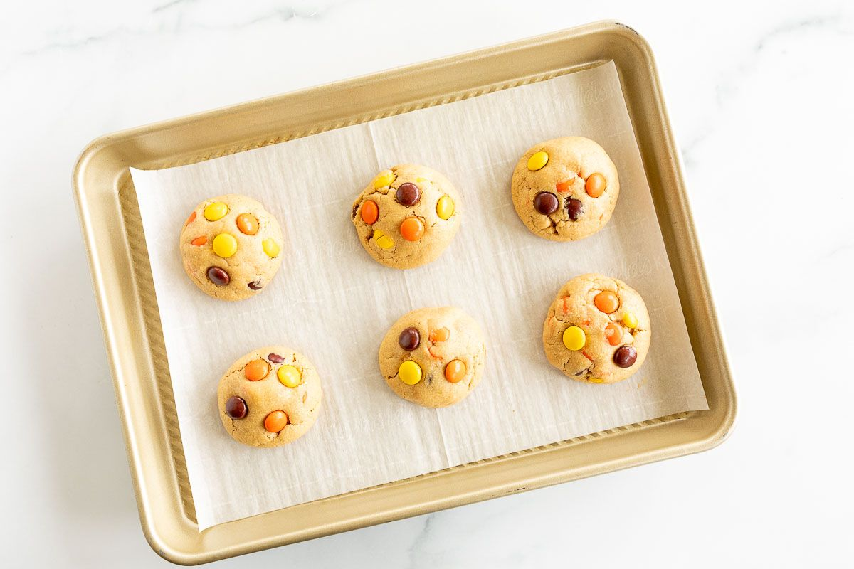 reeses candy cookies on a baking pan with parchment paper