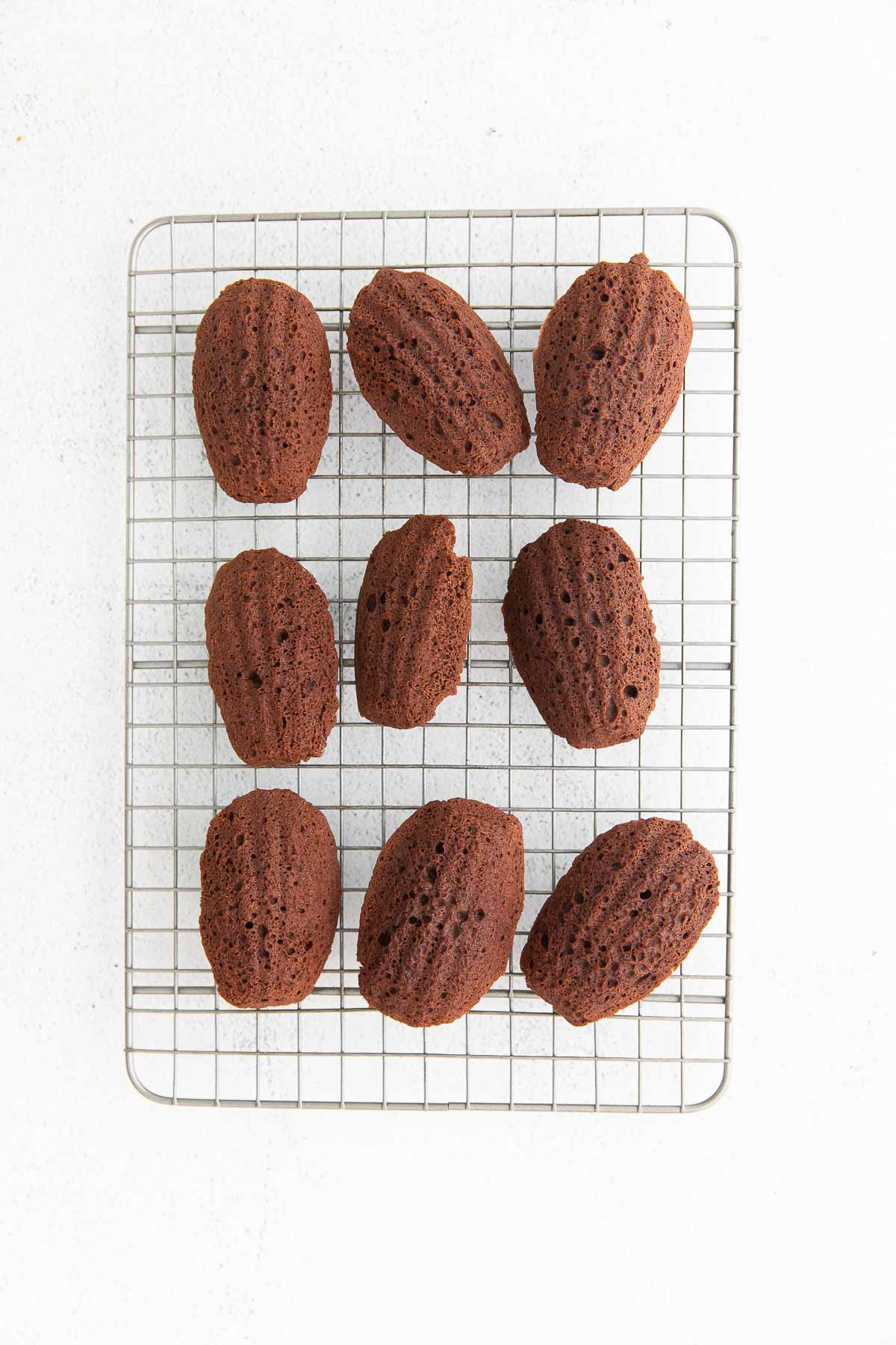 chocolate madeleines cooling on rack