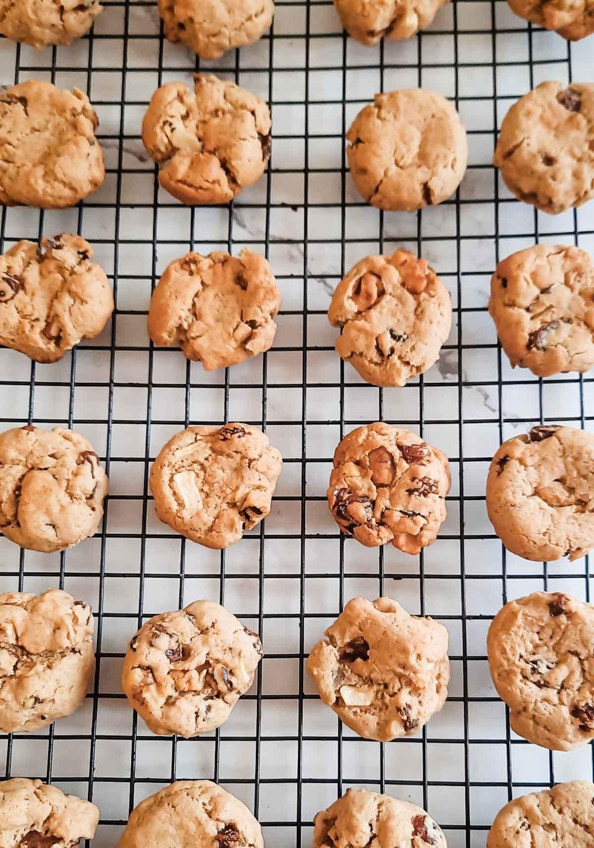 Apple raisin softie cookies on a baking sheet