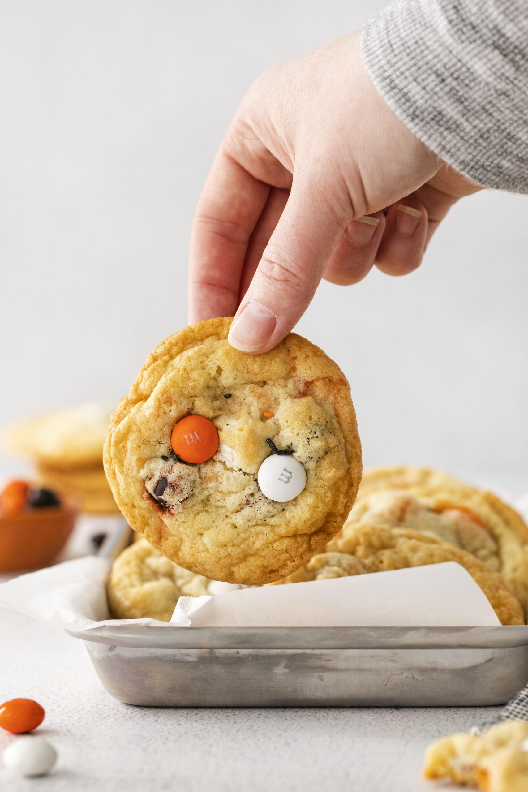 holding halloween cookie