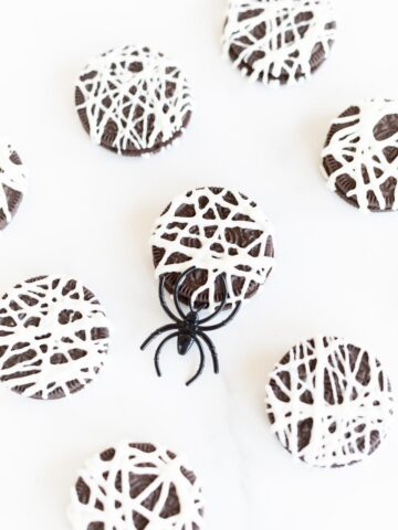 Spider cookies made from Oreos, on a white counter